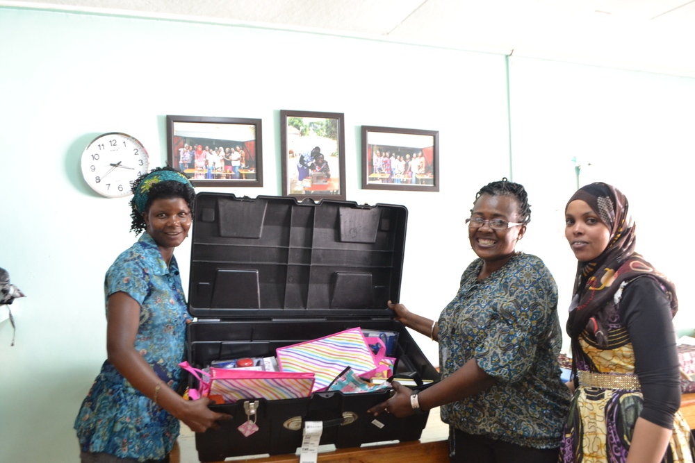 The women are pictured here with the sewing kits we collected for the sewing school in Uganda.