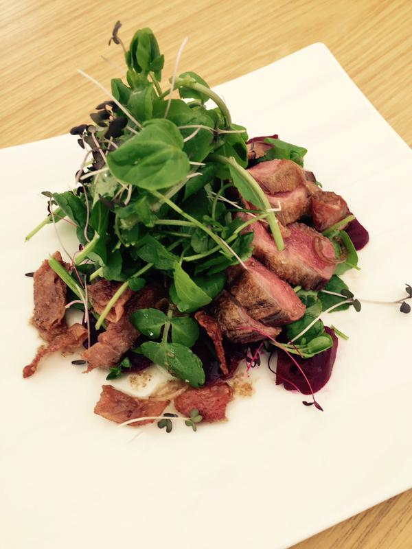 A salad of locally shot pigeon breast, beetroot and watercress with a pickled shallot and bacon dressing.