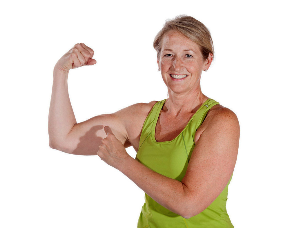 female-client-flexing-muscle-40-below-fitness-fairbanks-ak-web.jpg