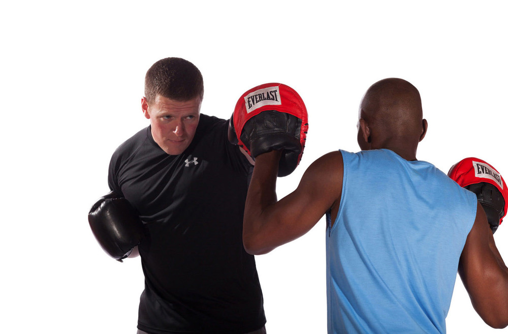 michael-flanagan-40-below-fitness-boxing-with-personal-fitness-client-male-close-up-web.jpg