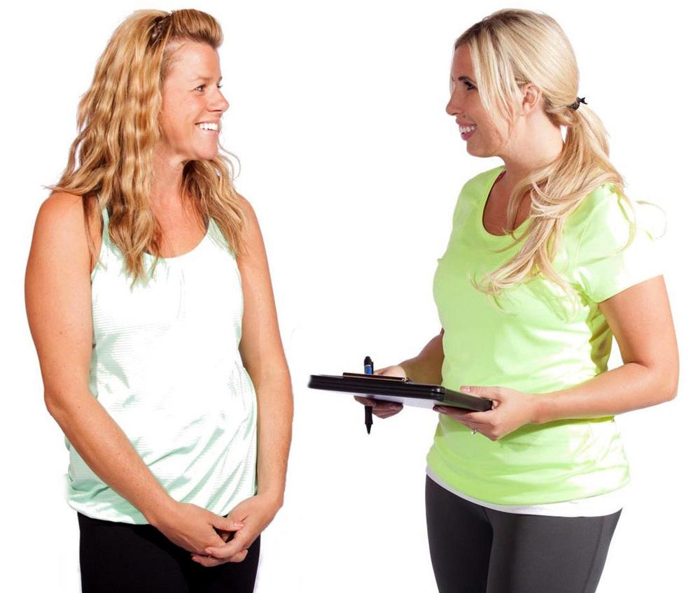 phoebe-flanagan-fitness-trainer-with-female-client-holding-clipboard-fairbanks-alaska-web.jpg