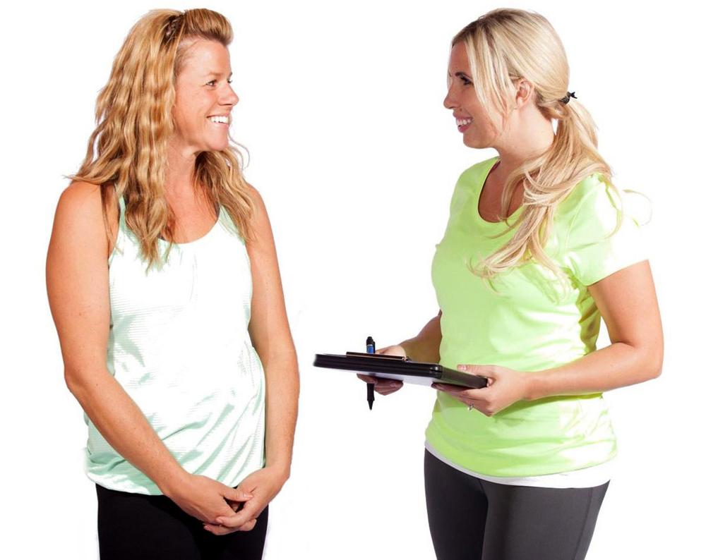 phoebe-flanagan-fitness-trainer-with-female-client-holding-clipboard-fairbanks-alaska-web-b.jpg