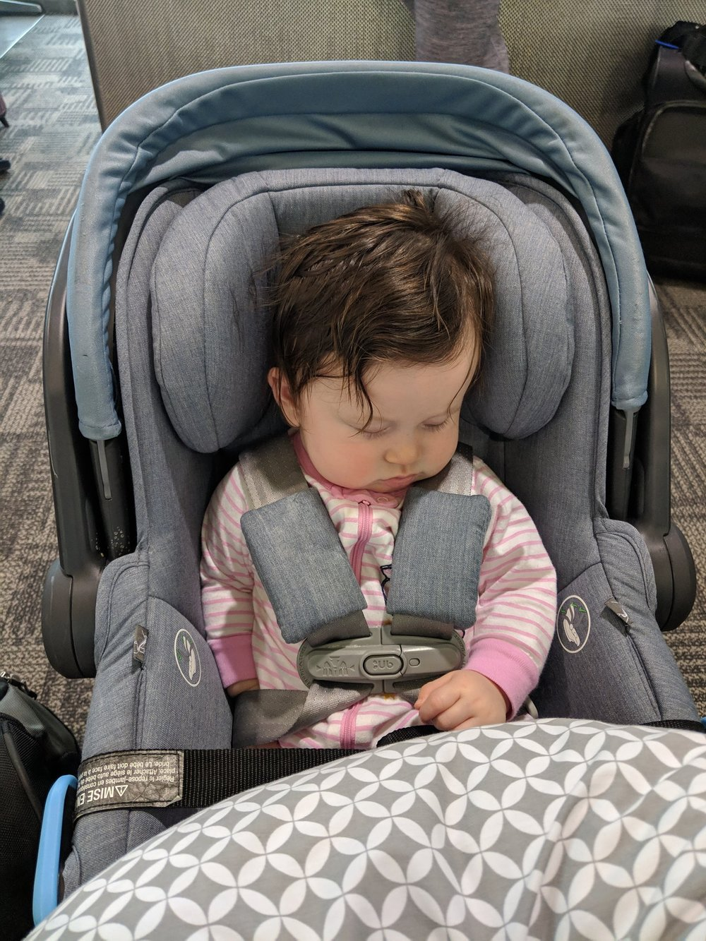Car seat, stroller, Boppy in the walking-through-the-airport configuration.