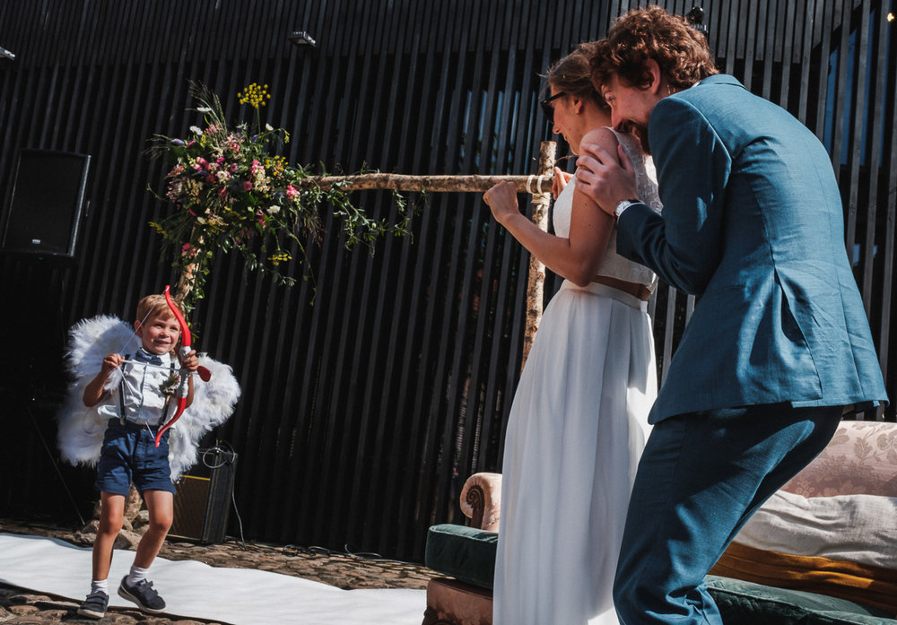 When you're in the middle of a wedding, and Cupid still fires arrows because you're so cute together #bride #groom #wedding #weddingday #weddingphoto #weddingphotography #weddingphotographer #weddingstyle #weddingdress #iso800 #love #hugs #kisses #mywed #fearless #ceremony #instawed #instalove #instalike #instagood #picoftheday #weddingbells #cupid #arrow #red #inlove