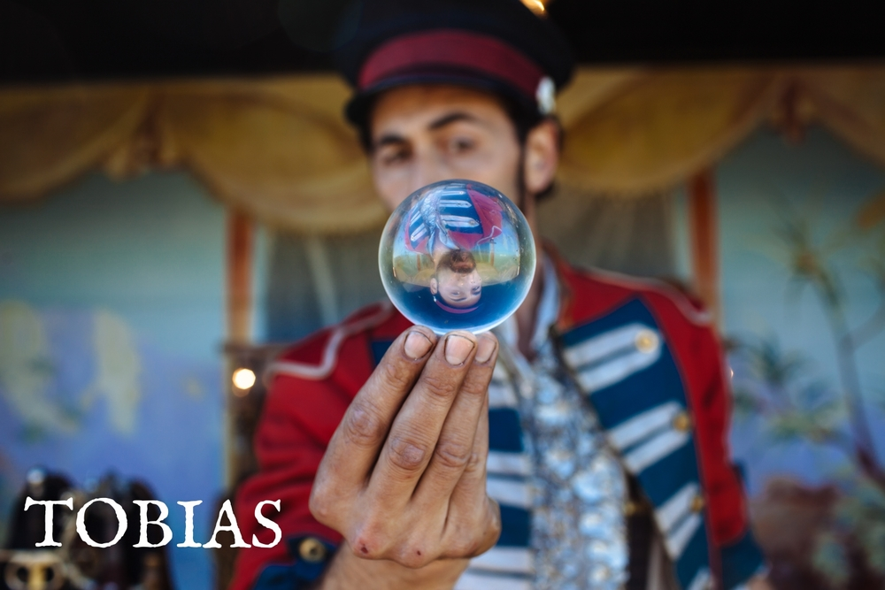Tobias has been performing magic and circus arts since the age of eleven and was a longtime member of internationally touring rock and roll vaudeville experience The Yard Dogs Road Show. For the past few years Tobias has combined his love of magic, circus and surrealism to build his own show, The Traveling Spectacular.