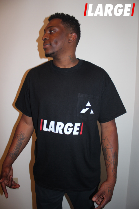 Rashard for LARGE, sporting the LARGE Pocket Tee in Black.