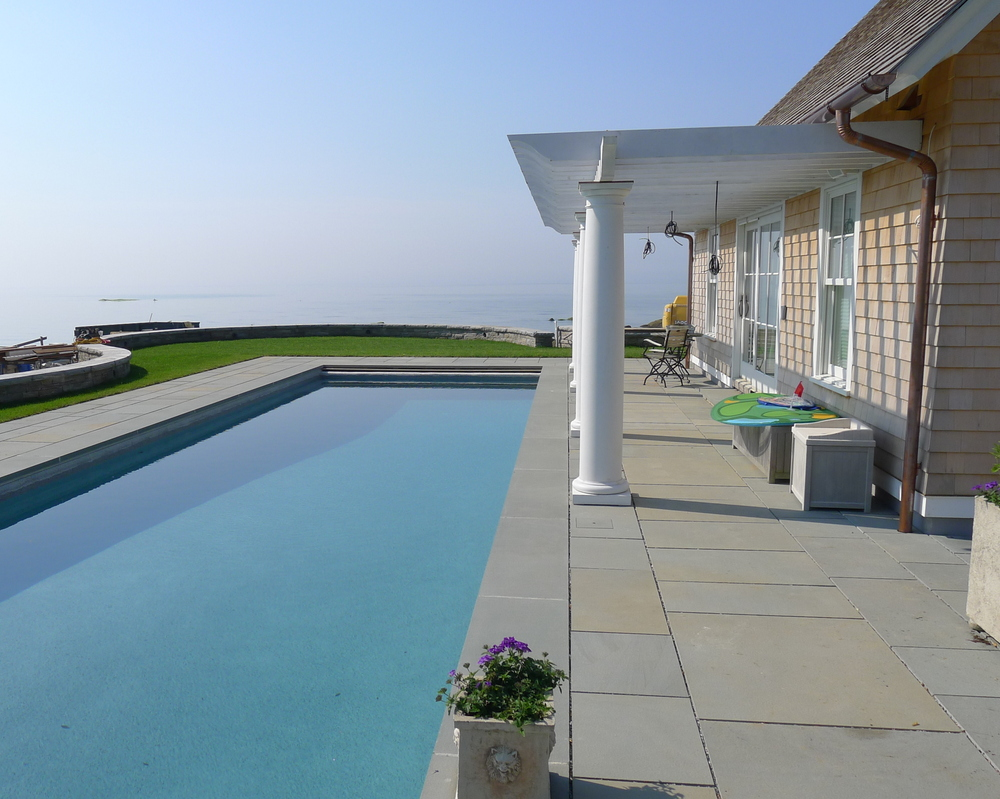 The pool and pool house with views out to Long Island Sound.