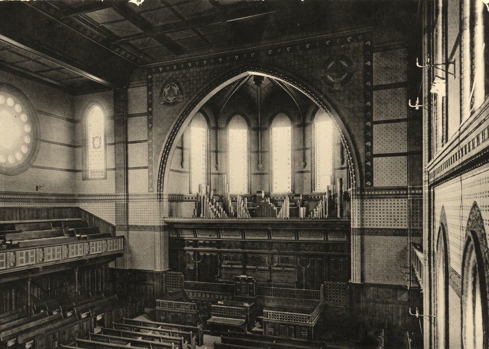 Looking east, before the south balcony was added. When the second (and third) organs were installed in the balcony to the left, the old organ and its imposing screen were removed. Note the gas lights on the walls.    Photo: Yale University Archives