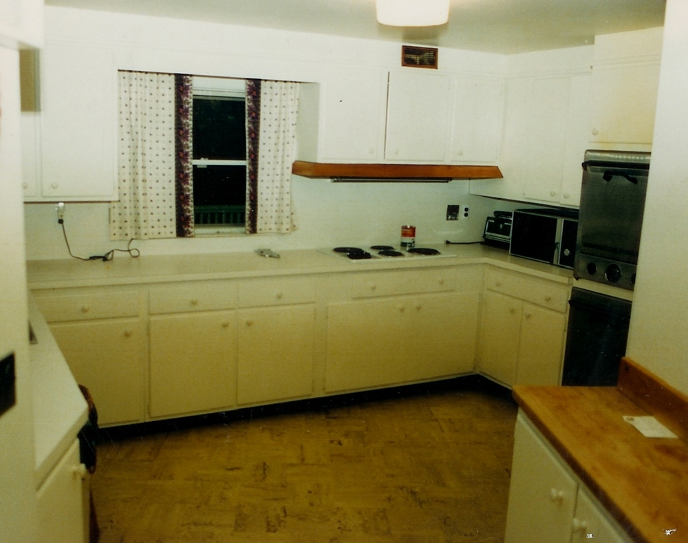 The original kitchen: dreariness was the order of the day. The window became the doorway to the new billiard room, and a new window at the left provides more light.