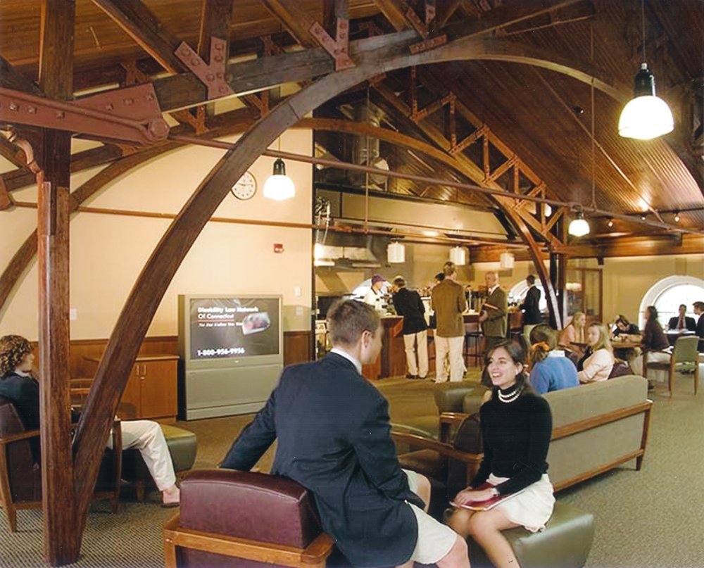 The Tuck Shop, now the Olmsted Student Union, under the refinished roof structure of the old Lewis Gym.     Photo: Pomfret School