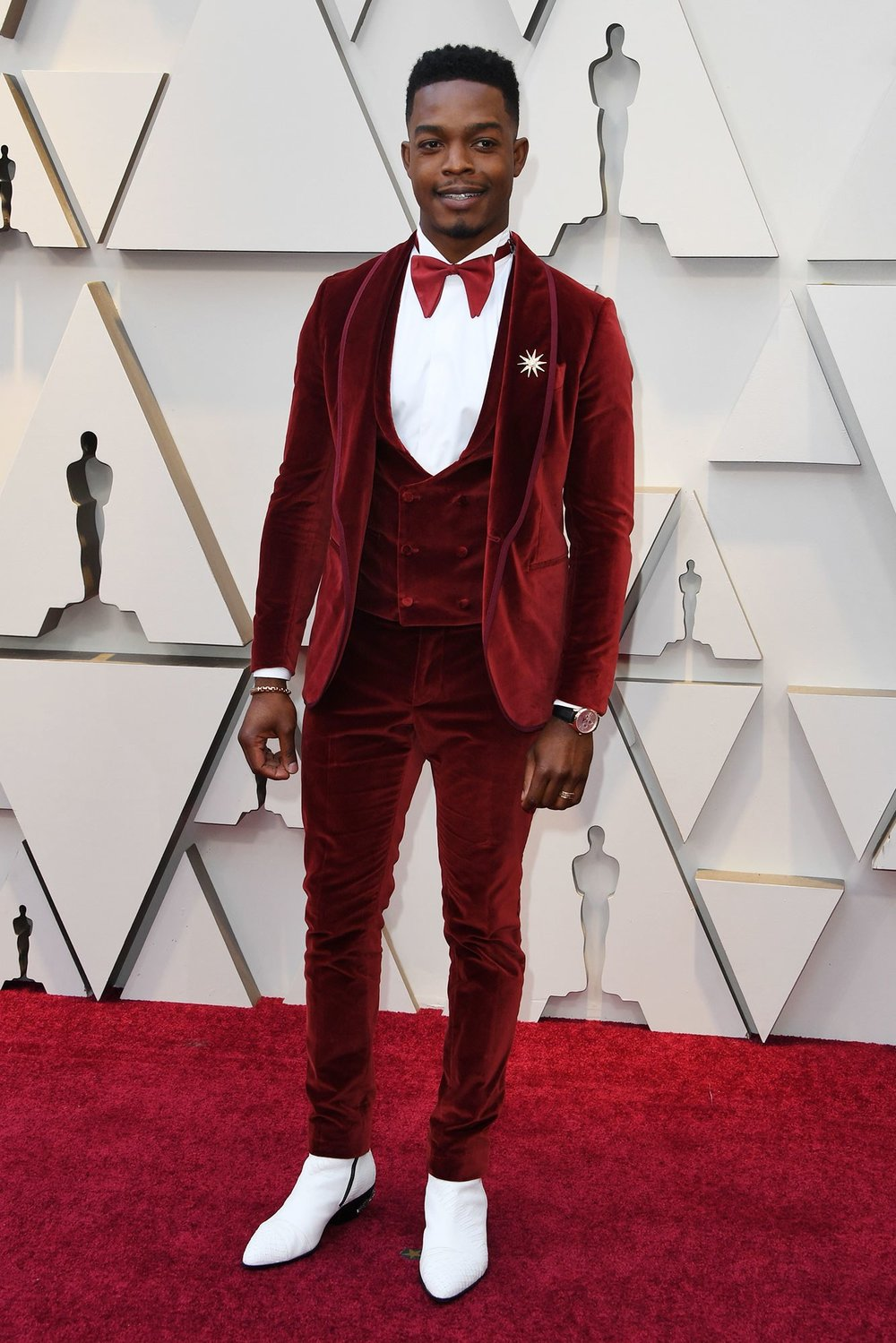 STEPHAN JAMES - ETRO: This Canadian boy is killing it! Red velvet, lapel pin and white boots! Love!