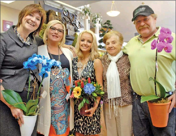 Wascana Flower Shoppe is staffed by family. Shown here are Petra Janssen (left),   Tanya Anderson (Janssen Class of 2000)  , Laurissa Janssen, Erika Wefel and Ewald Janssen.     Picture Courtesy Don Healy – Regina Leader Post