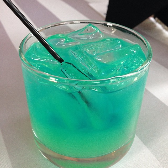 How incredibly  stunning  is the color of The Bride's custom drink, the Blue Bombshell?!