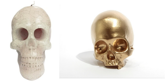 bleeding skull candle ,  gold skull  .