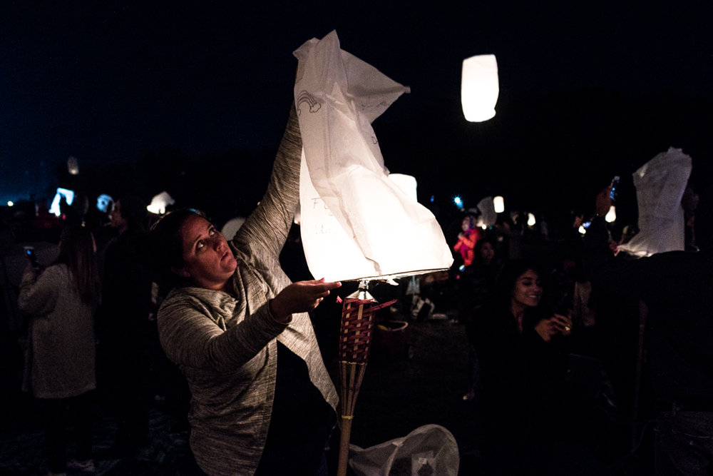 My wife getting ready to send our first lantern to the heavens.