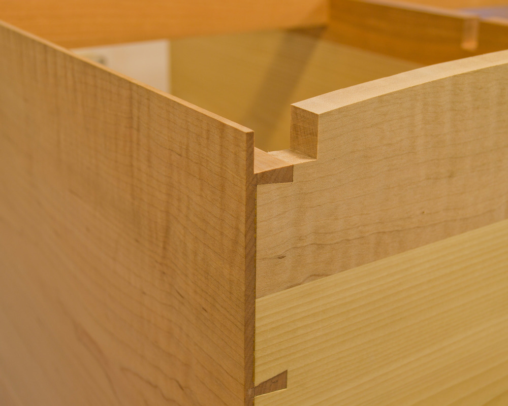 Dovetails, again.  You can also see the rabbet on the front of the side which will accept a vertical stile.