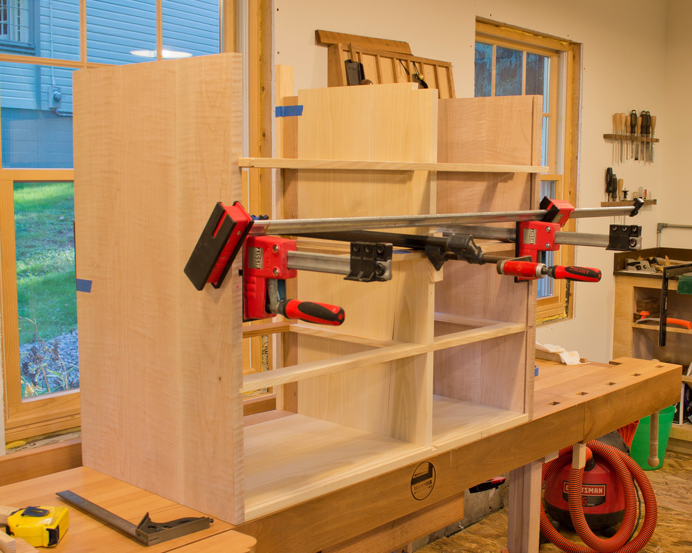 I'm using clamps to pull  one of the rear horizontal dividers into position.  Again, sliding dovetails and half laps.