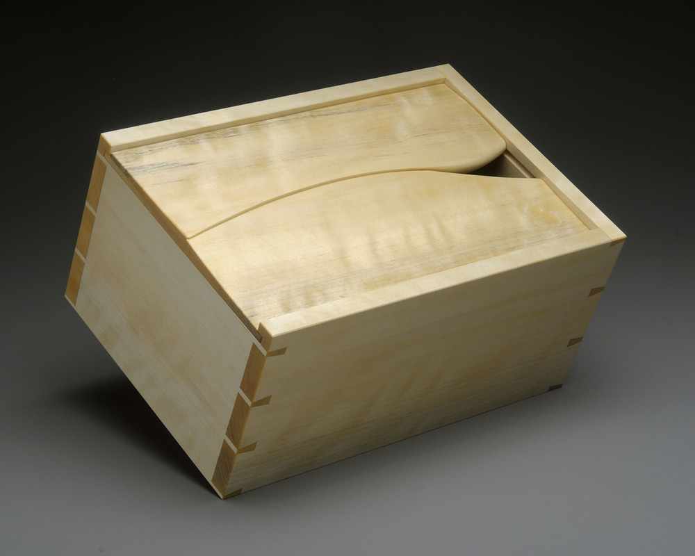 """El Cubano   El Cubano? Well, someone suggested that the sculpted lid of this box makes it look like a fancy humidor. So I went with it and named it after a cigar. It is made of Yellow Birch, with a touch of flame figure.    7.5"""" W x 11"""" L x 5"""" D    Photos by Charley Freiberg"""