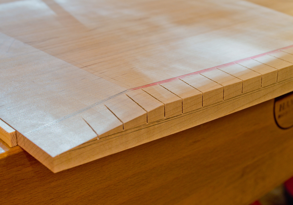 Close-up of the saw-kerfed edge.  Notice the layout lines - they are so important in achieving the final shape.
