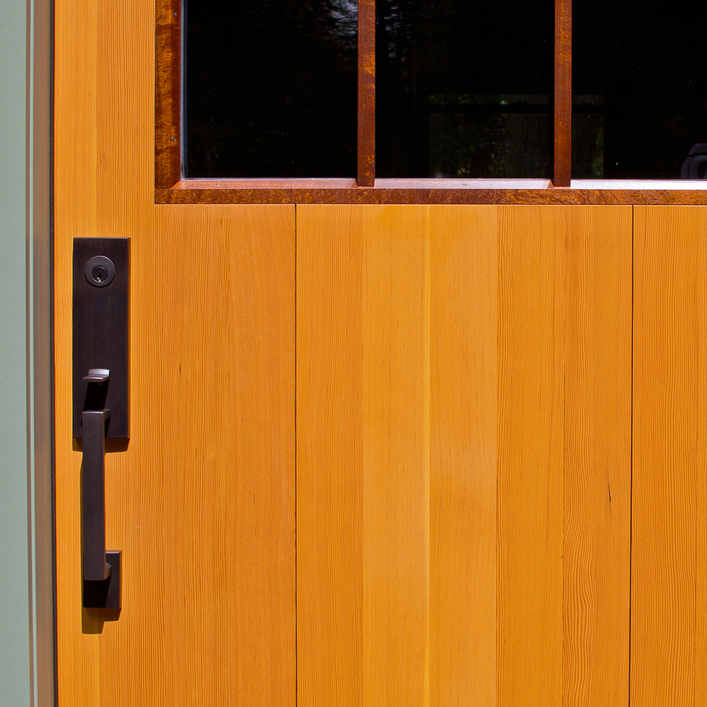 The door to the studio: a custom entry door made of Douglas-fir and mahogany.  An example of creative design, fine detailing and impeccable craftsmanship.