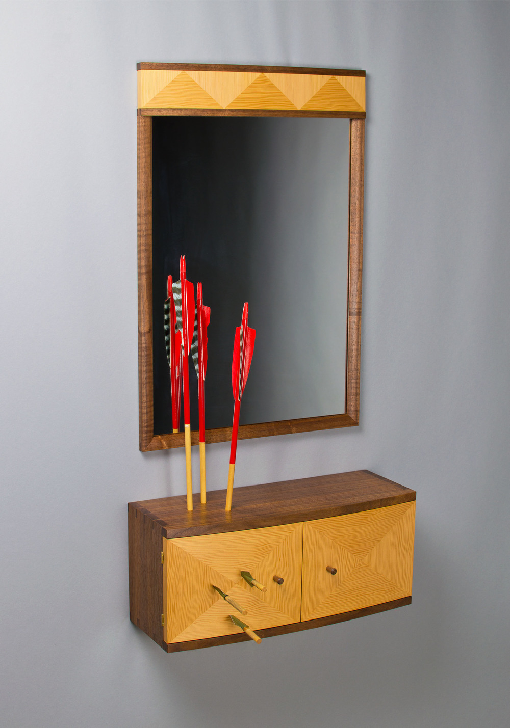 black walnut wall cabinet and mirror with douglas-fir veneer. the cabinet has been shot wiht arrows