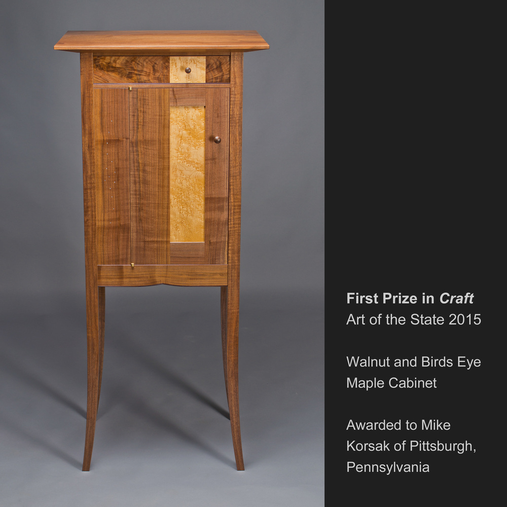 the award-winning cabinet made of black walnut and birds eye maple