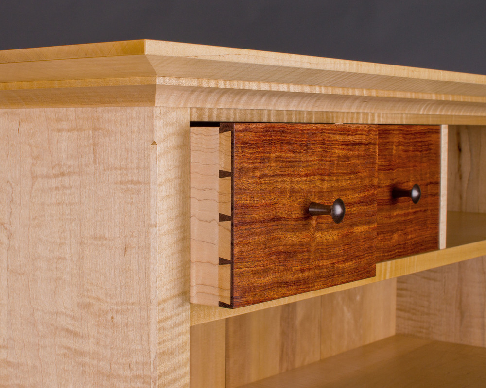 drawers feature hand-cut dovetail joints, the epitome of craftsmanship