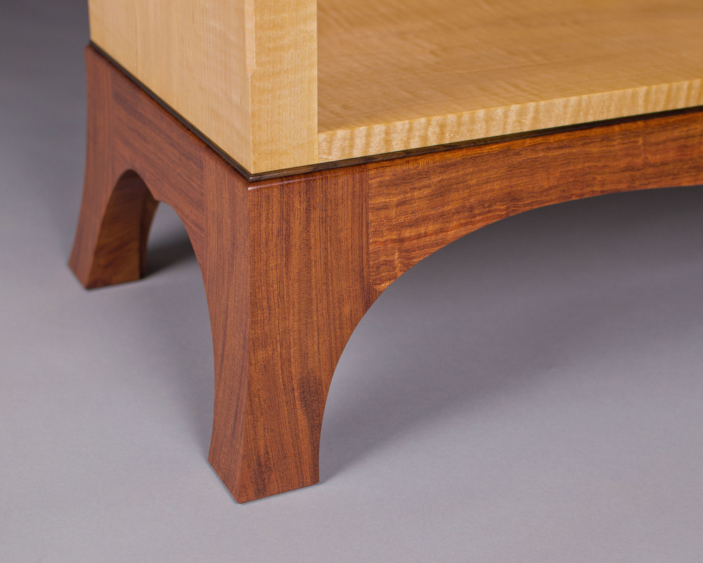 the base of the bookcase is finely detailed, with flared feet and a rosewood bead