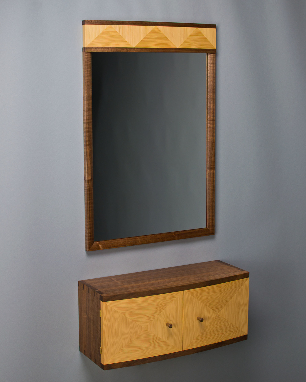 a mirror and wall cabinet made of black walnut and douglas-fir