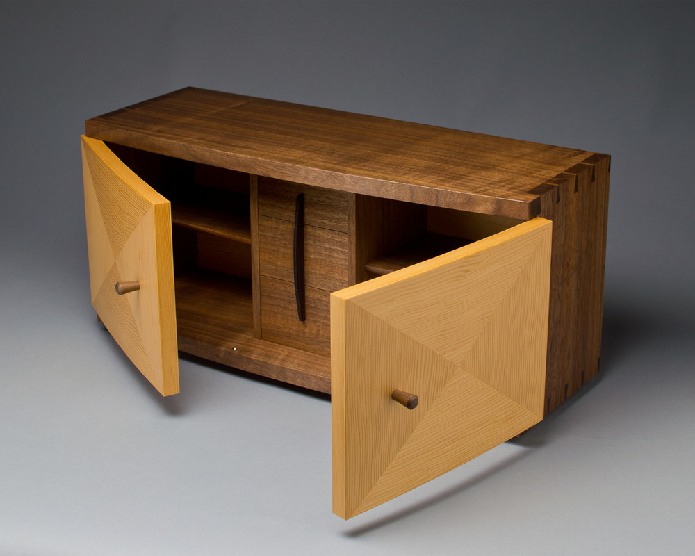 the doors of the cabinet are curved, made with laminations of douglas-fir veneer