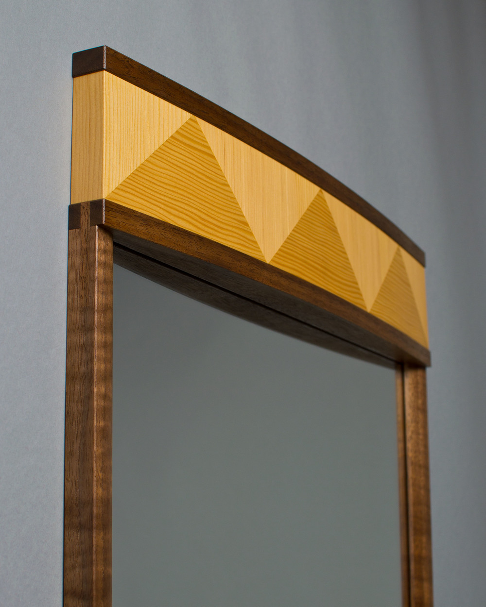 curved crown on top of mirror made of douglas-fir veneer