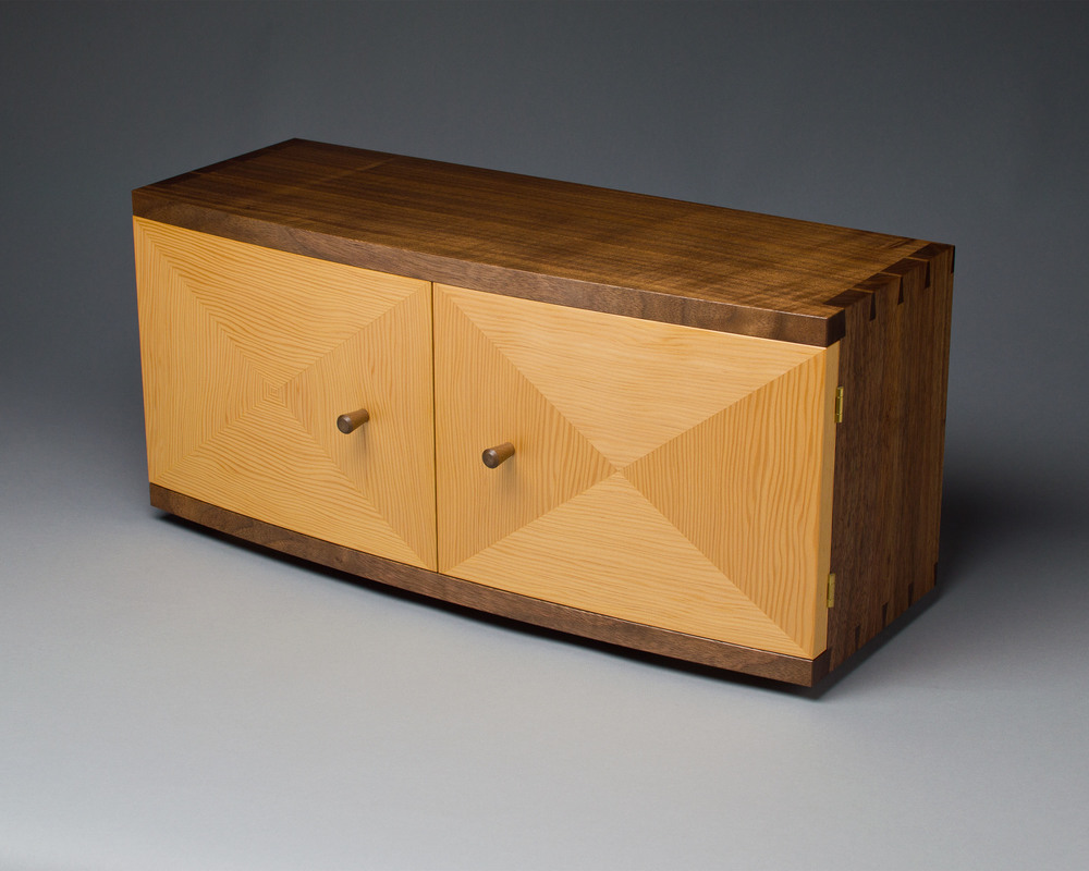 the cabinet case features hand cut dovetail joinery