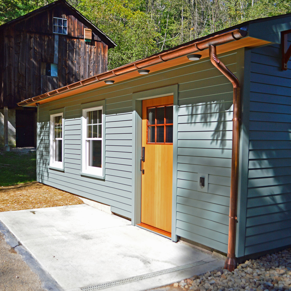 The exterior of Mike's studio.  Note the details that make this a special building: the custom Douglas-fir and mahogany entry door, copper gutters, and meticulous trim detailing.