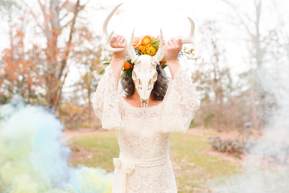 Boho Bride with deer skull and smoke bomb