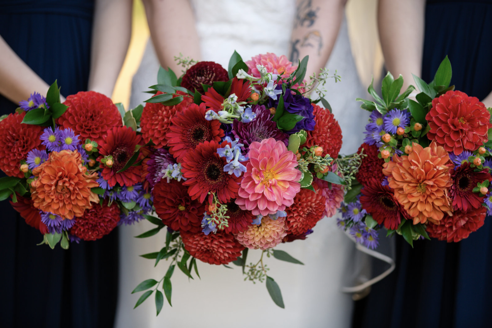 Bridemaids bouquets of dahlia and gerbera daisy
