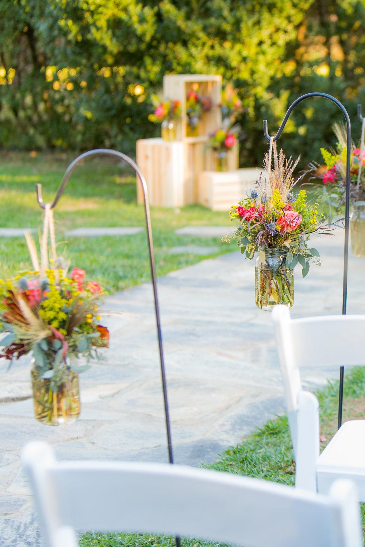 Aisle flowers on shepard's hooks