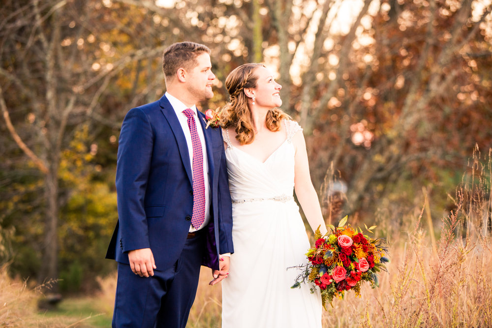 Bride and Groom at Rust Manor Wedding with bouquet by Lark Floral