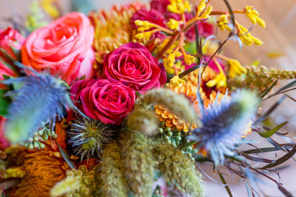 Textural mix of fall flowers with millet, thistle, kangaroo paw, agonis, roses, mums, by Lark Floral, Leesburg wedding florist