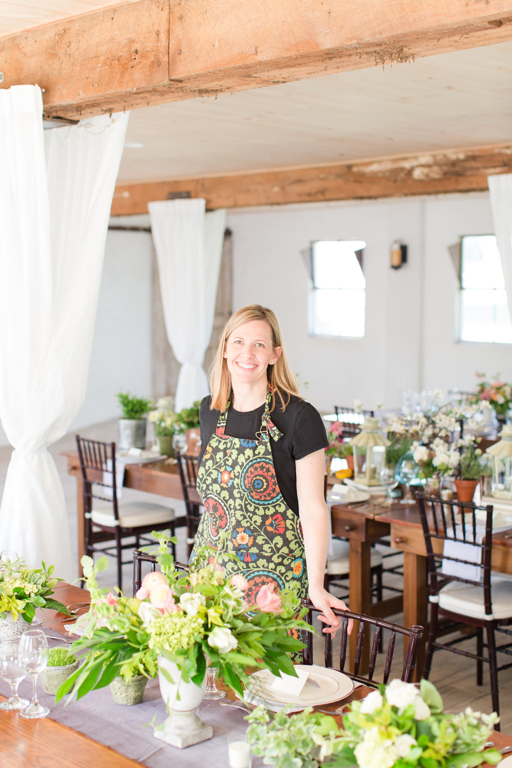 I had so much fun designing for this dinner! The fresh greenery, seasonal flowers (tulips! ranunculus! daffodil! dogwood!), and potted plants running along the farmhouse tables really brought the spring time vibe to the event. The best part, though, was getting to sit down to enjoy the deeeelicious food and have an opportunity to meet so many other creative professionals from the Loudoun County area!