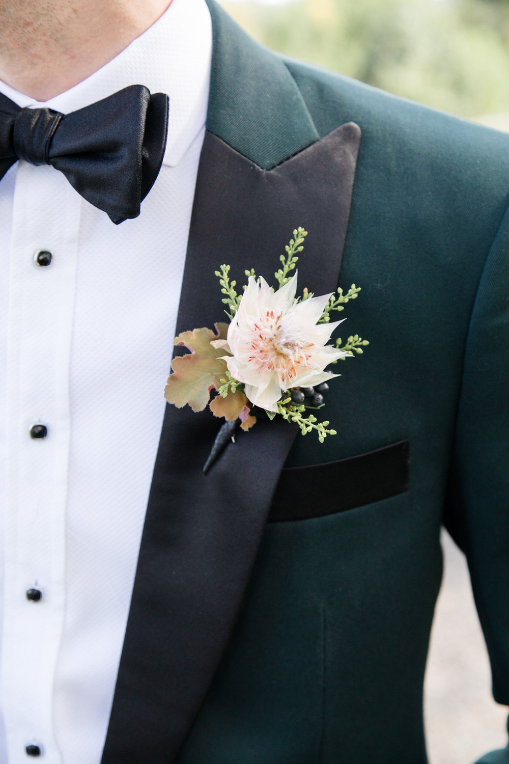 Groom's blushing bride protea boutonniere