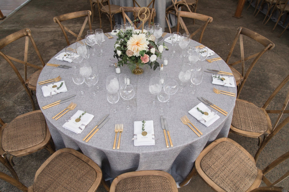 Round table with gray linen at Tranquility Farm