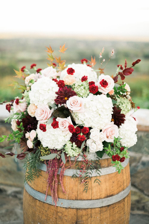flowers on wine barrel.jpg