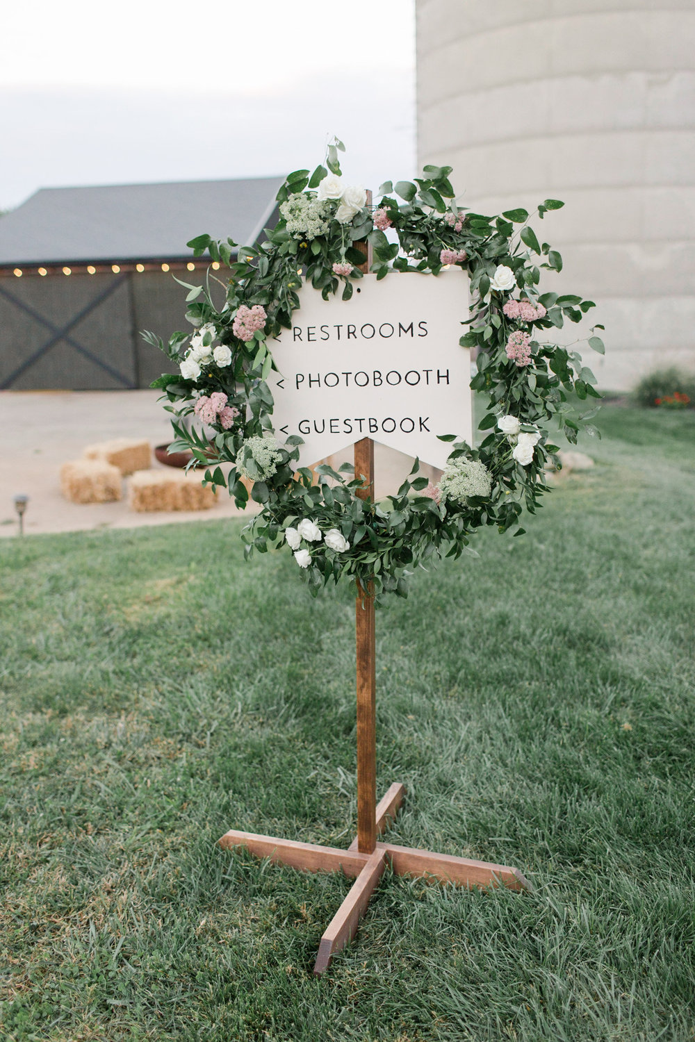 Wreath on directional signage