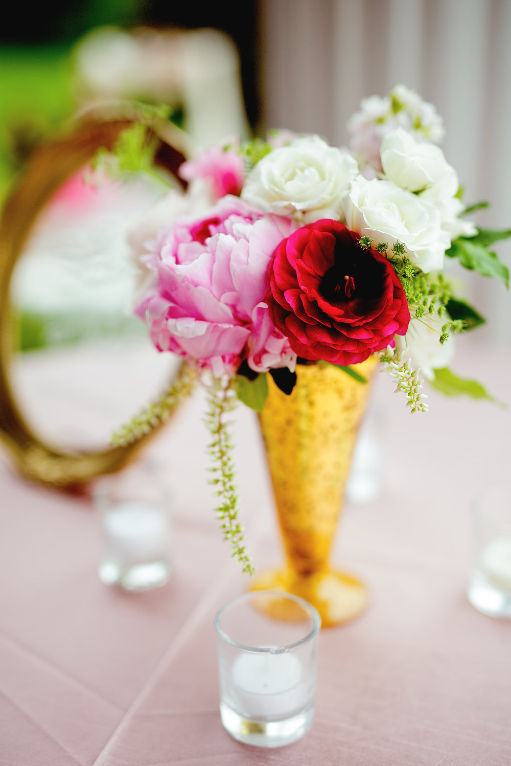Cocktail flowers in gold vase