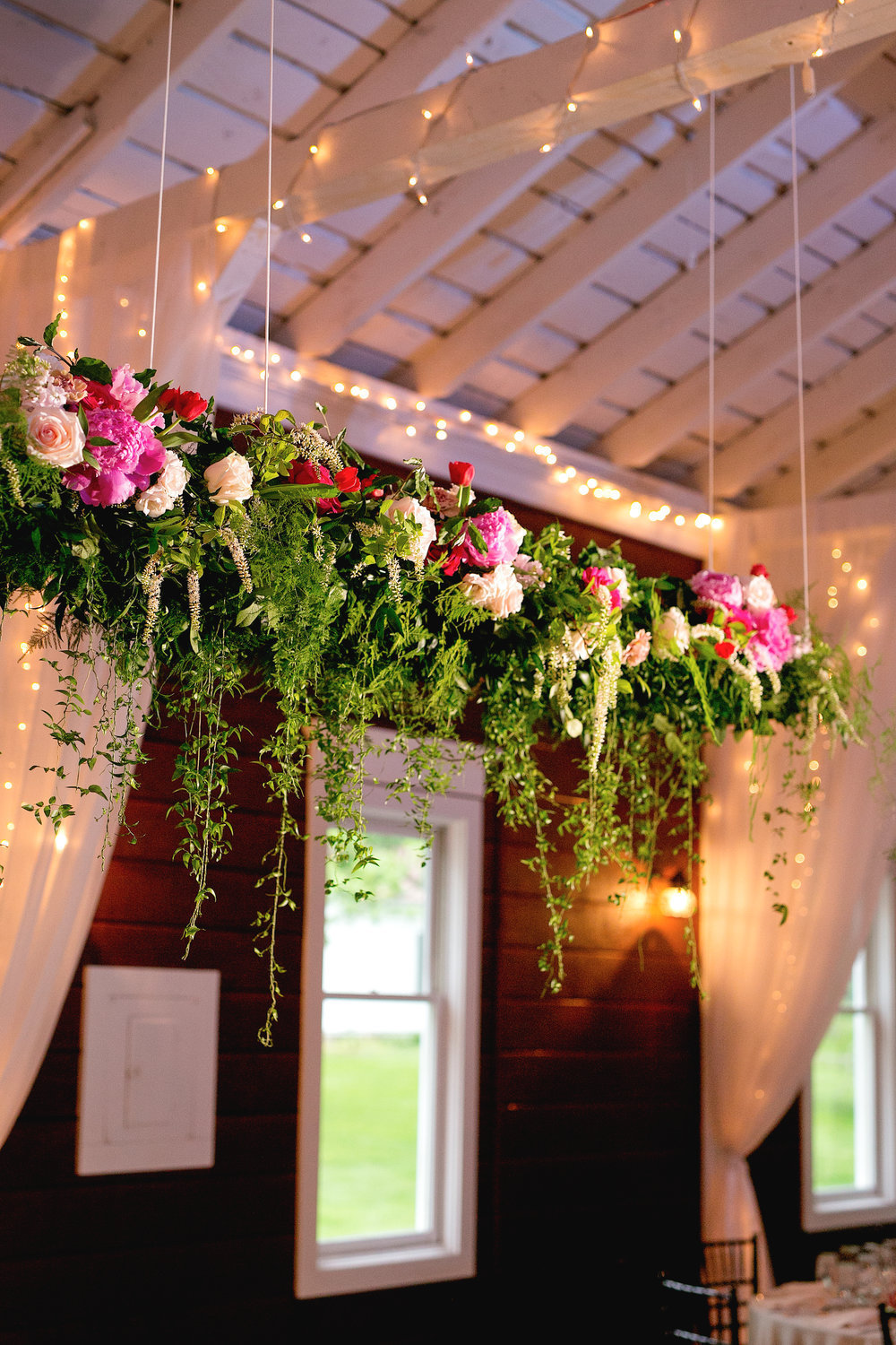 Floral installation above sweetheart table by Lark Floral at Historic  Rosemont Manor