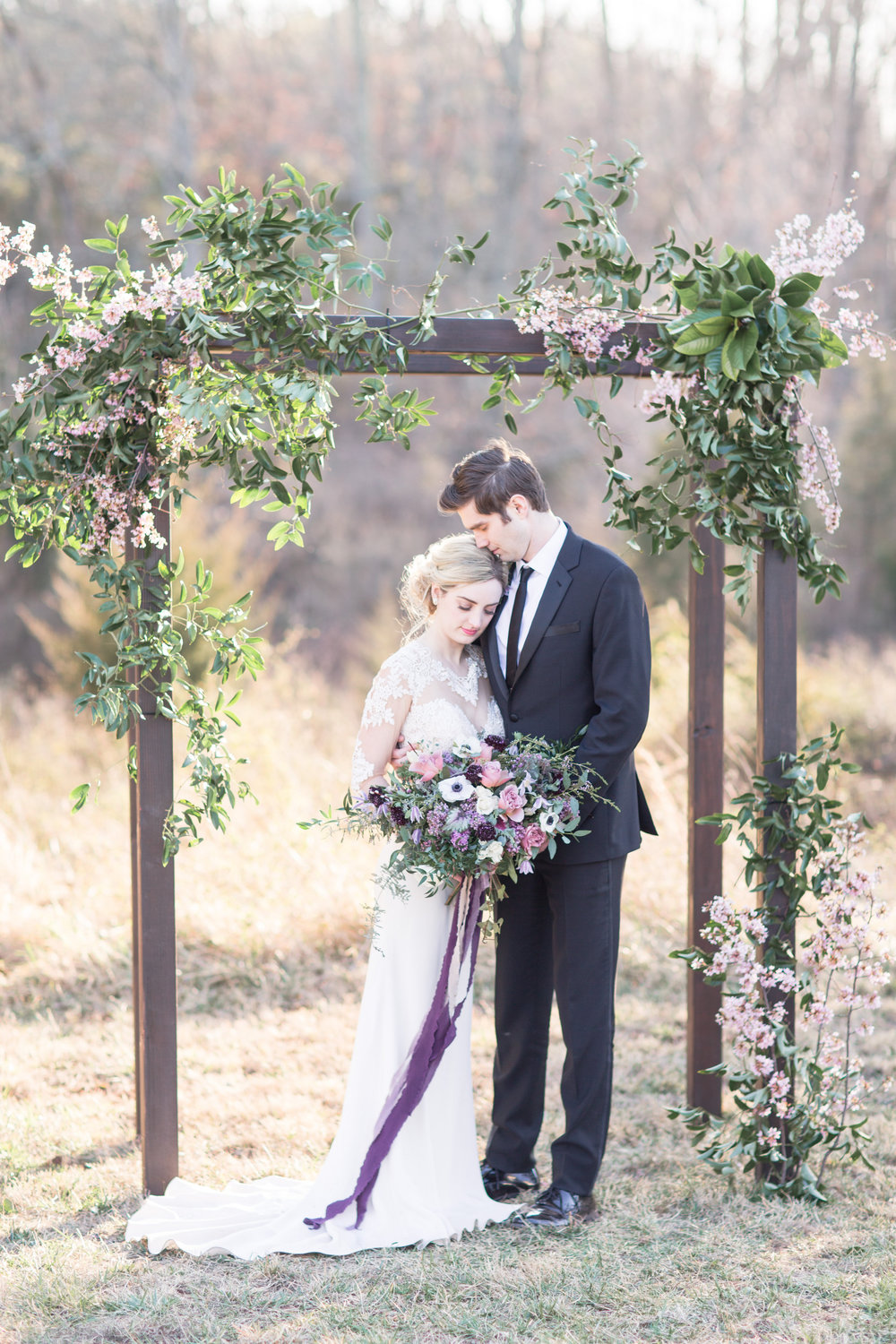Wedding arch with cherry blossoms by Lark Floral, Leesburg, VA florist