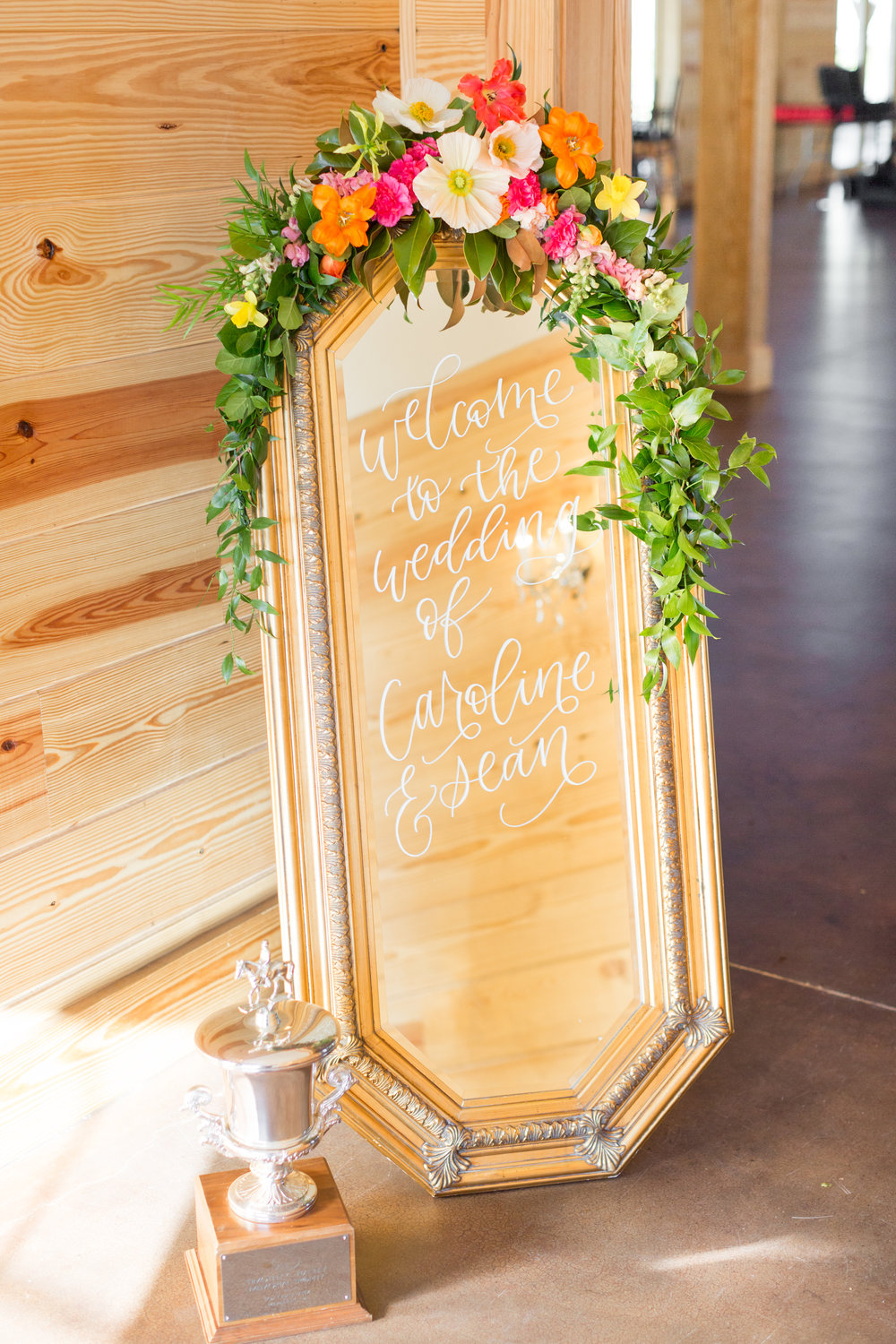 Welcome sign at wedding with flowers