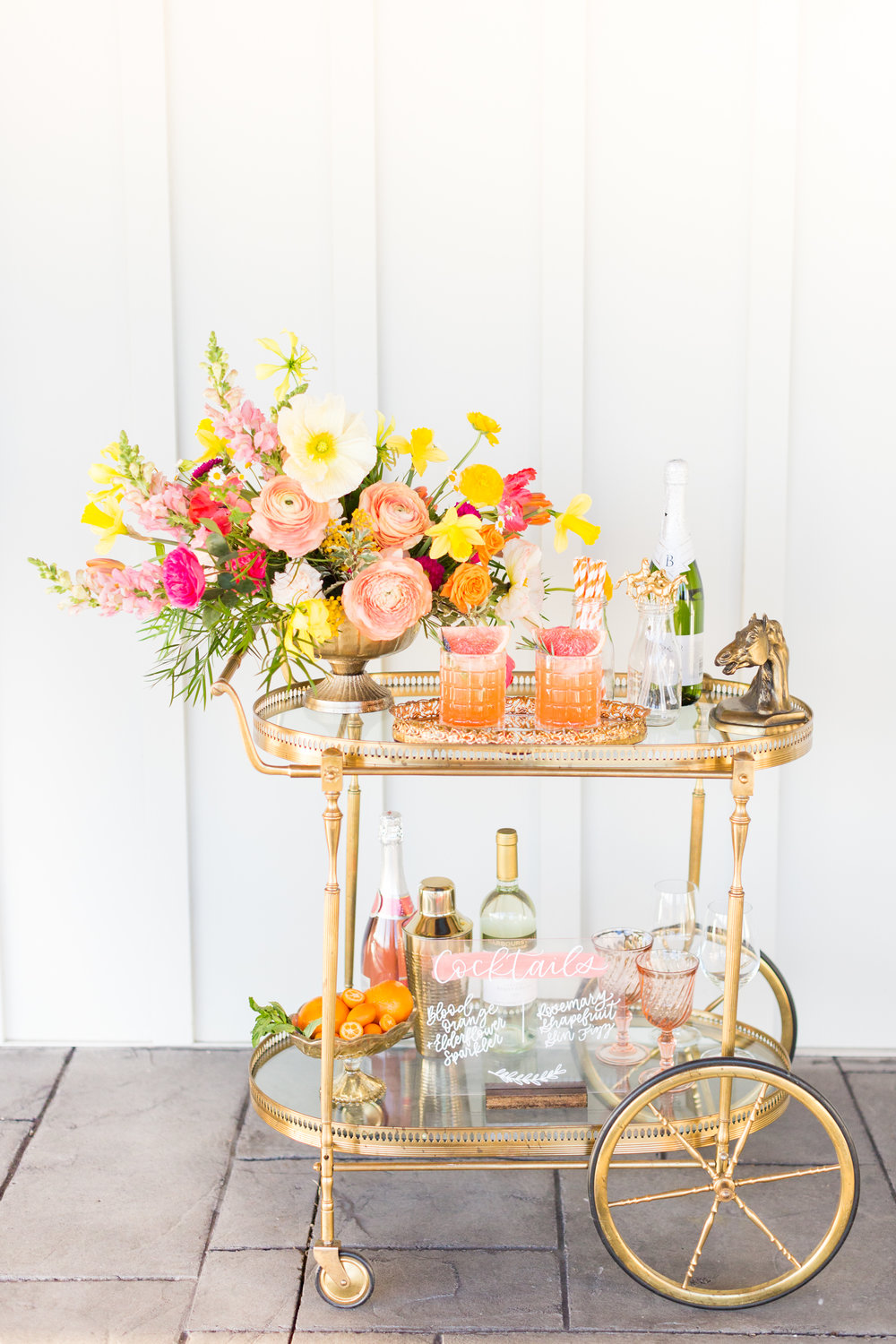 Vintage bar cart with flowers and cocktails