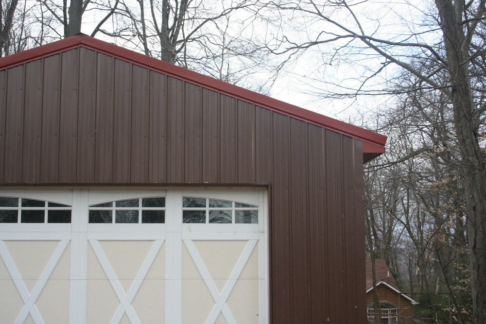 A close up of the new garage siding and door.