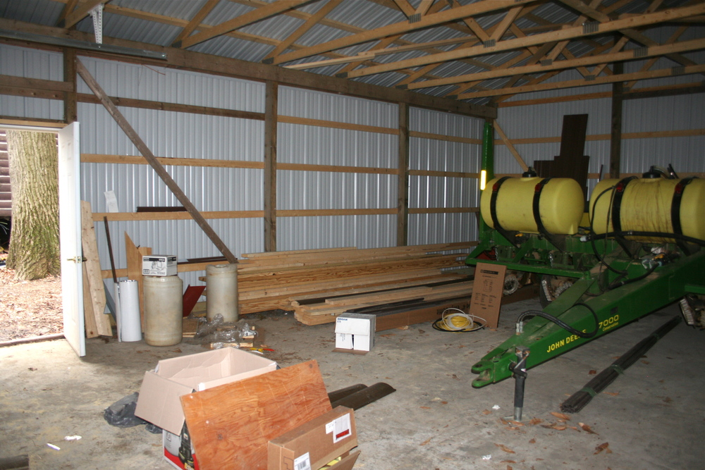 The garage is currently home to a mess of building supplies and a corn planter. There's nothing a farmer loves more than another empty garage at his disposal.